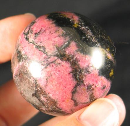 Black & Pink Rhodonite Sphere :: Image is of piece for sale.